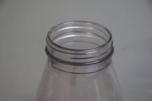 Early Australian Shell Embossed Quart Oil Bottle