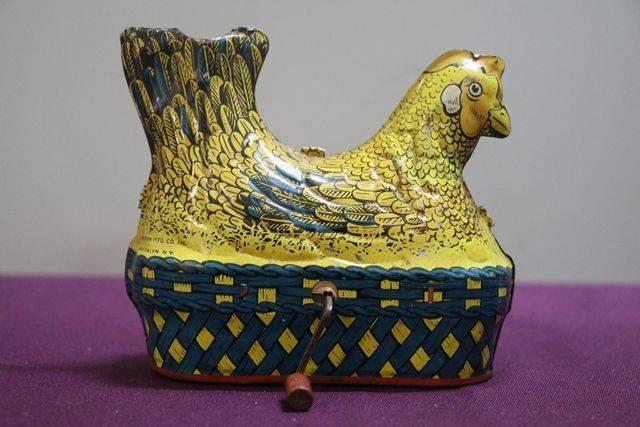 A Baldwin MFG Company Clockwork Tinplate Model Of A Hen Nesting