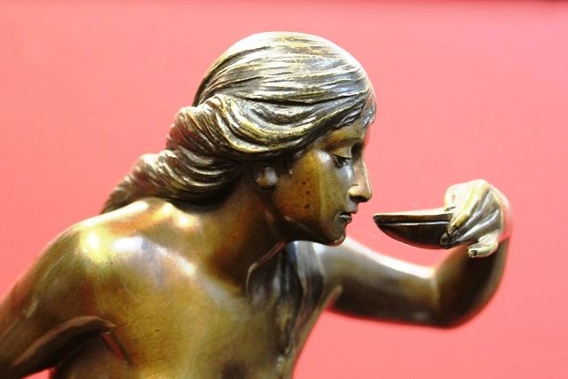 A Stunning Bronze Nude Figure of a Woman