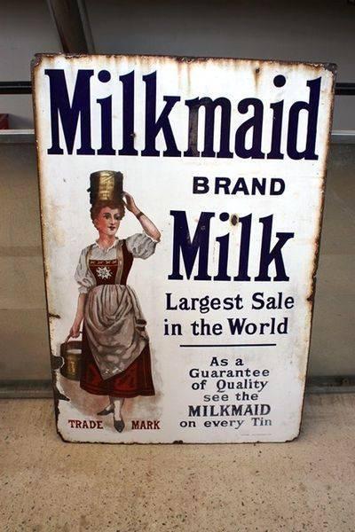 Antique Milkmaid Pictorial Enamel Sign Arriving Nov