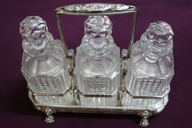 Antique Victorian Cut Glass 3 Bottle Tantalus in a Silver Plated