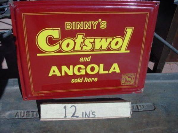 Binnys Cotswol + Angola Fabrics sold here enamel sign