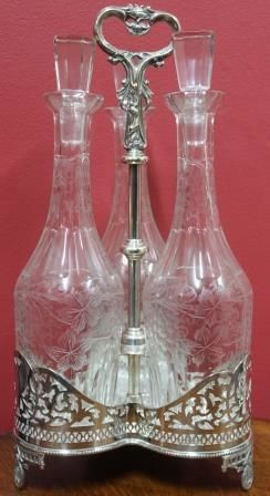 Victorian SilverPlated Tantalus with 3 Wine Decanters