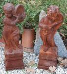 Pair Of Cast Iron Musical Cherubs On Stands ---