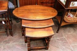 A Quality Early C20th Oak Oval Nest of 3 Tables