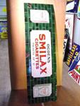 OGDENS SMILAX STRIP SIGN ---ST86
