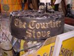THE COURTIER STOVE ADV FIGURE--LARGE--- ADV 9