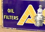 AC Oil Filters + Plugs Pictorial Enamel Sign