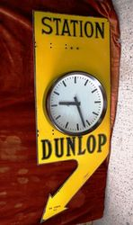 ARRIVING SOON Dunlop Double Sided Clock Enamel Sign
