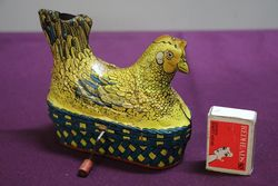 A Baldwin MFG Company Clockwork Tinplate Model Of A Hen Nesting