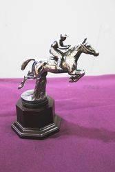 A Desmo Mascot of Horse + Jockey