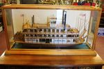 A Large Cased Model Of A River Paddle Steamer