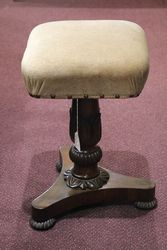 A Late Regency Craved Revolving Piano Stool C1820