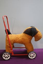 A PushAlong Soft Toy Dog On Wheels