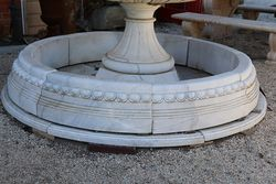 A Round White Marble Pond Base and Surround