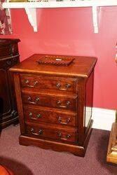 A Small C20th Oak File Cabinet
