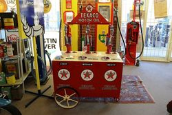A Stunning 3 Pump Texaco Oil Cart