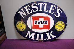 A Vintage Nestles Milk Oval Enamel Sign