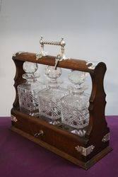 Cut Glass 3 Bottle Tantalus Housed in a Lockable Oak Case