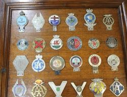 Framed and Mounted Collection of 30 Car Badges