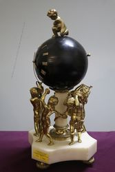 French Bell Strike Clock In Round Black Ball On top Of Cherubs