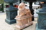 Pair of Large Tiger Eye Marble Lions on Stands.